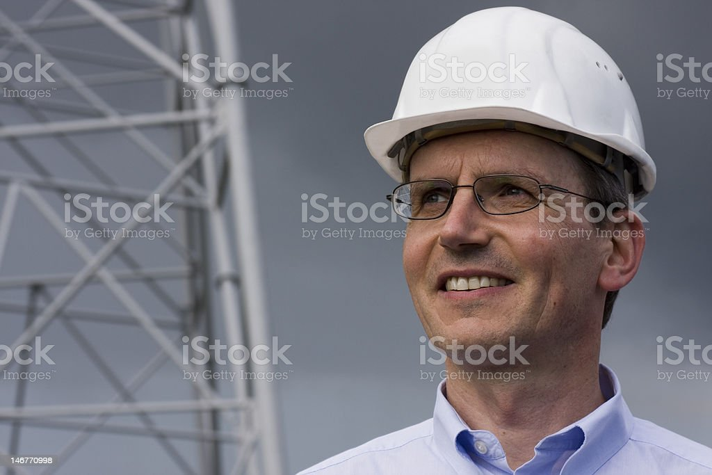 Smiling engineer with hardhat royalty-free stock photo