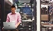 Smiling engineer working on laptop