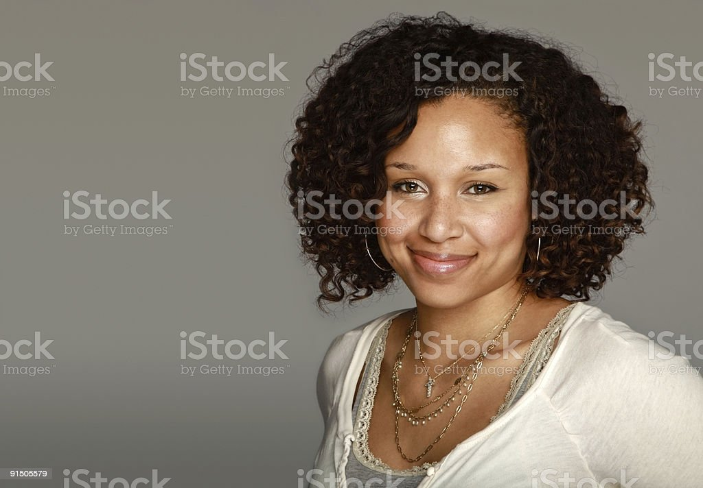Smiling Ethnic Woman Portrait with Curly Brown Hair stock photo