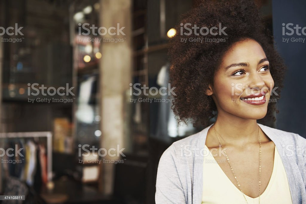 Smiling ethnic woman standing outside coffee house stock photo