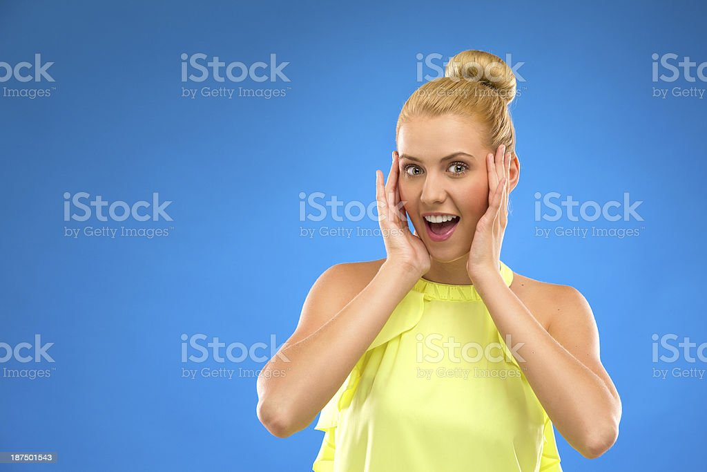 Smiling excited woman looking at camera. stock photo