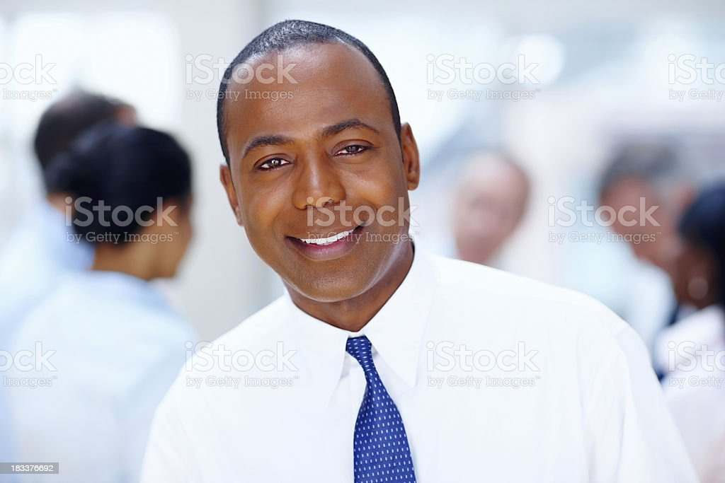 Smiling executive at the office royalty-free stock photo