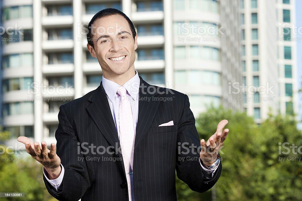 Smiling Executive Offers His Best Sales Pitch royalty-free stock photo