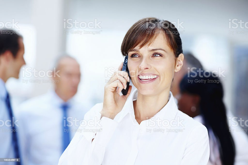 Smiling executive talking on the phone royalty-free stock photo