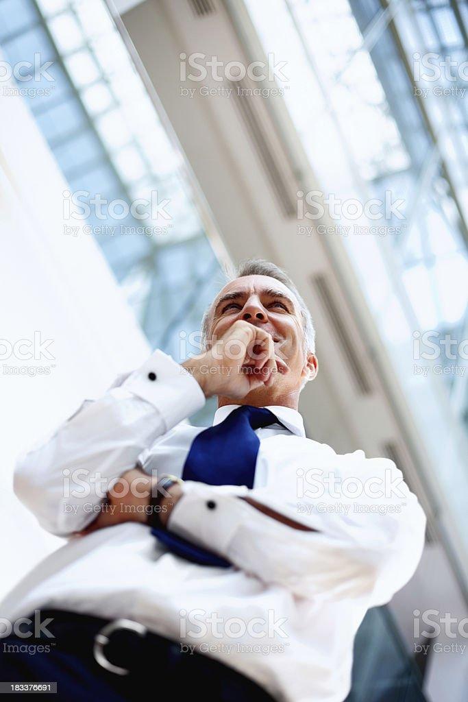 Smiling executive thinking royalty-free stock photo