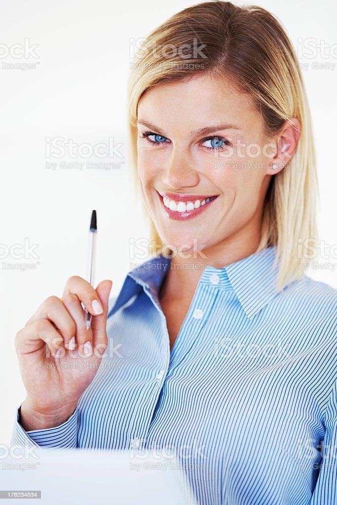Smiling executive with folder stock photo