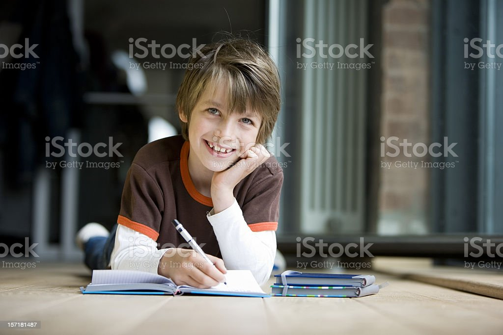 Smiling eye contact from an adolescent boy studying at home royalty-free stock photo