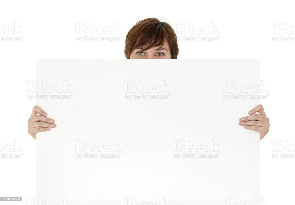 Smiling eyes behind a blank banner ad royalty-free stock photo
