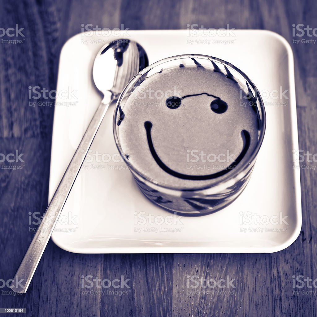 Smiling Face on a Coffee Cream Glass royalty-free stock photo