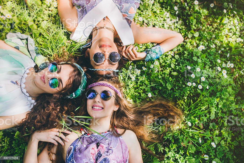 Smiling faces of hippie female friends stock photo