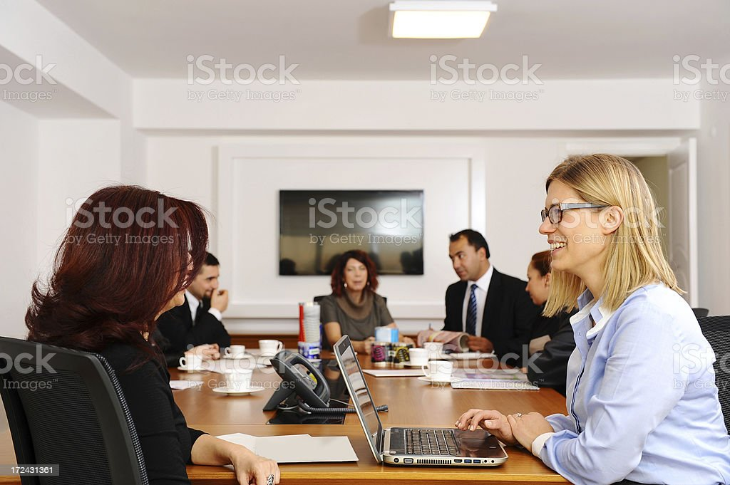 Smiling faces on job interview stock photo