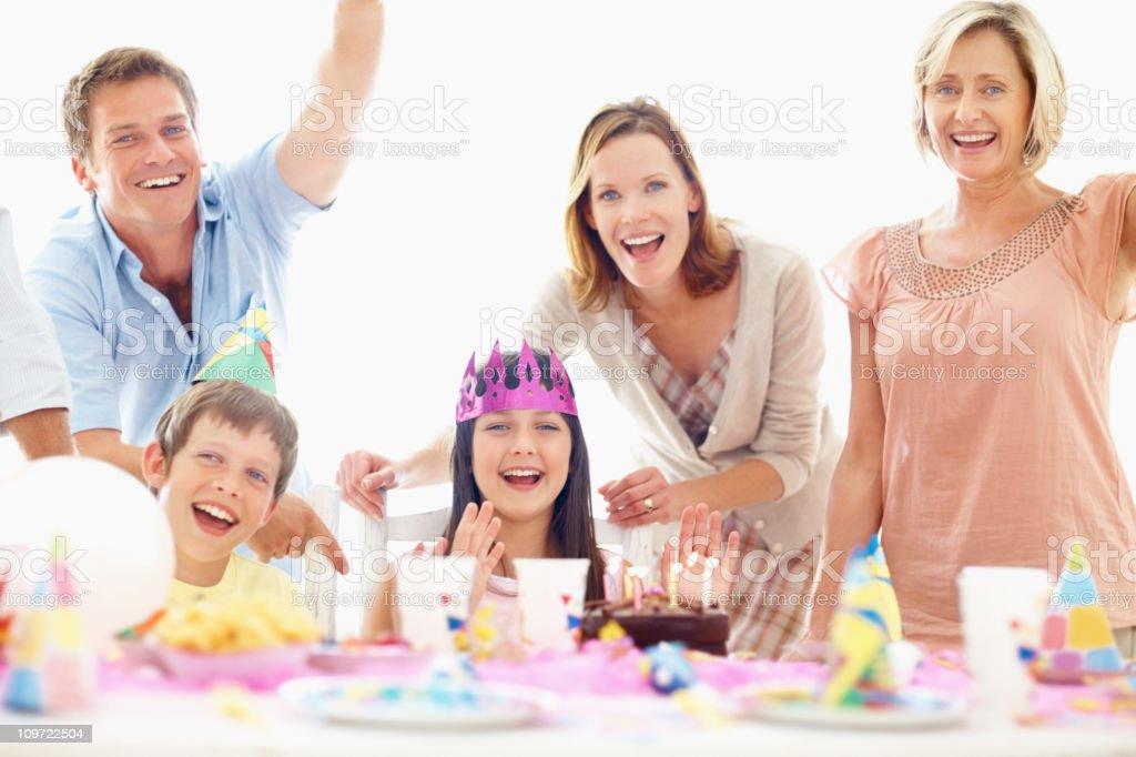 Smiling family celebrating a birthday party royalty-free stock photo
