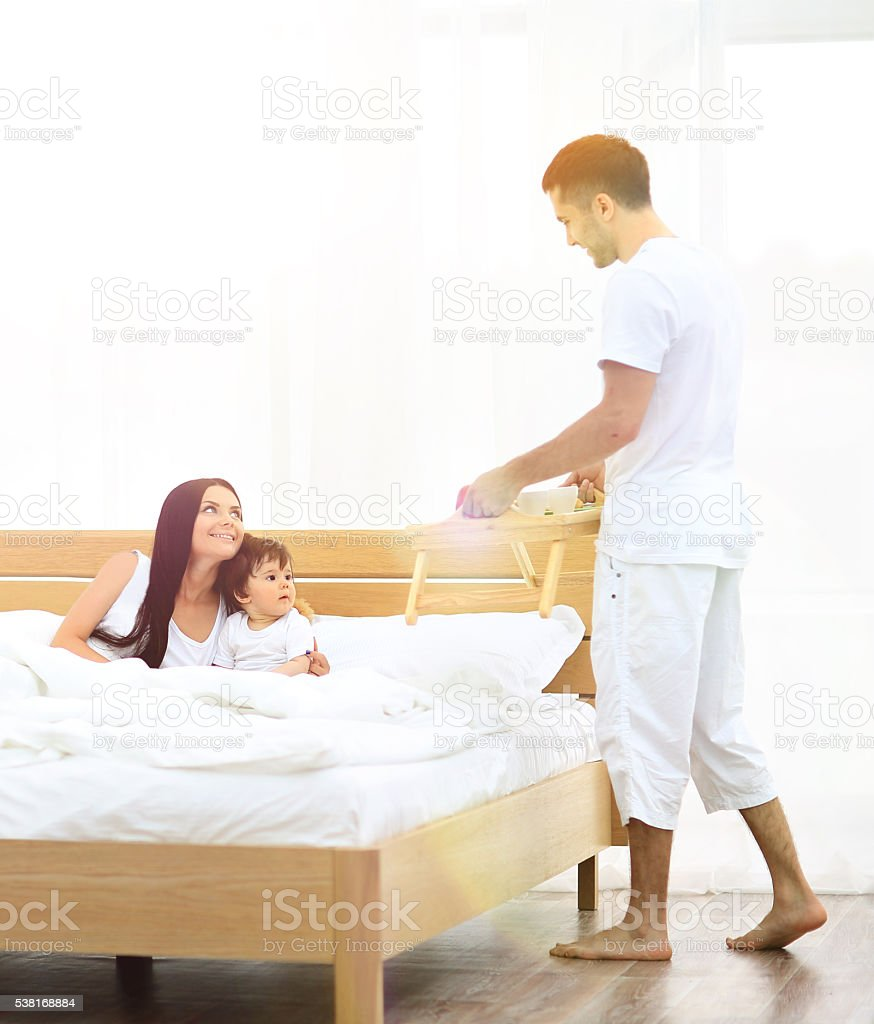 Smiling family having breakfast stock photo