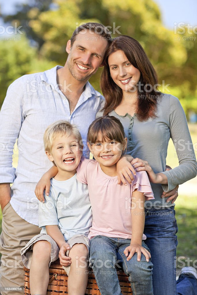 Smiling family picnicking in the park royalty-free stock photo