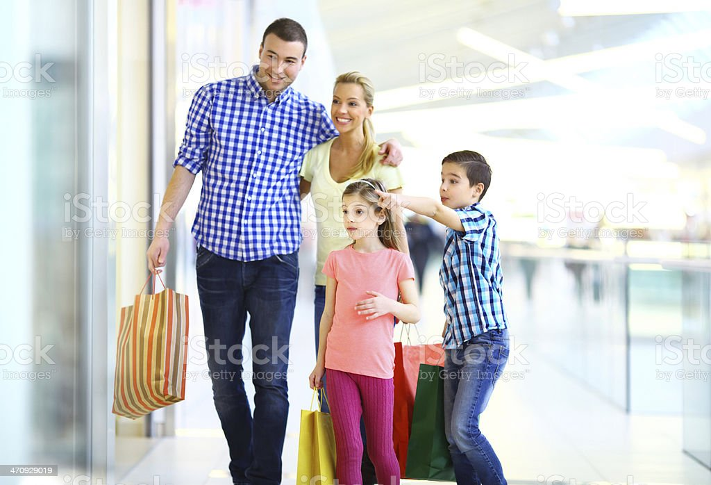 Smiling family shopping together royalty-free stock photo