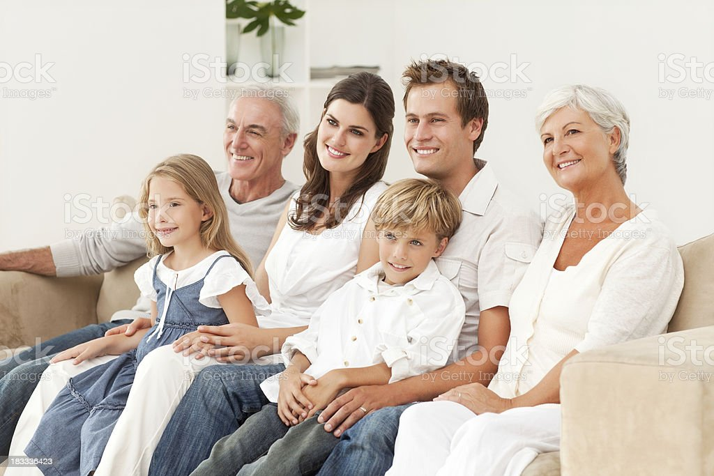 Smiling Family Sitting On Couch royalty-free stock photo