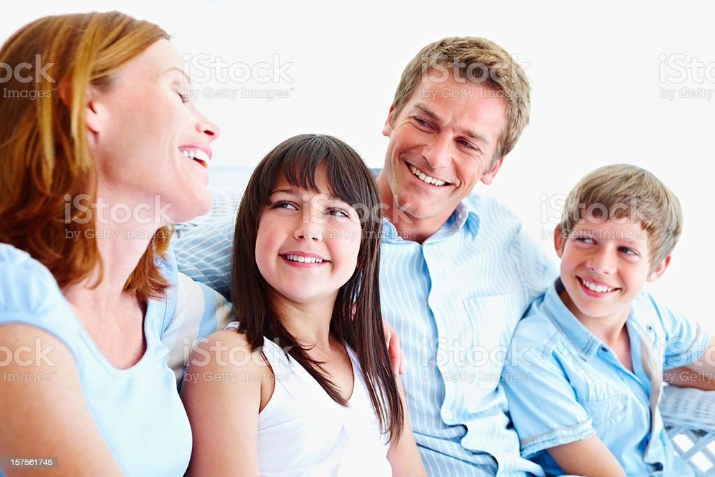 Smiling family spending a quality time together royalty-free stock photo