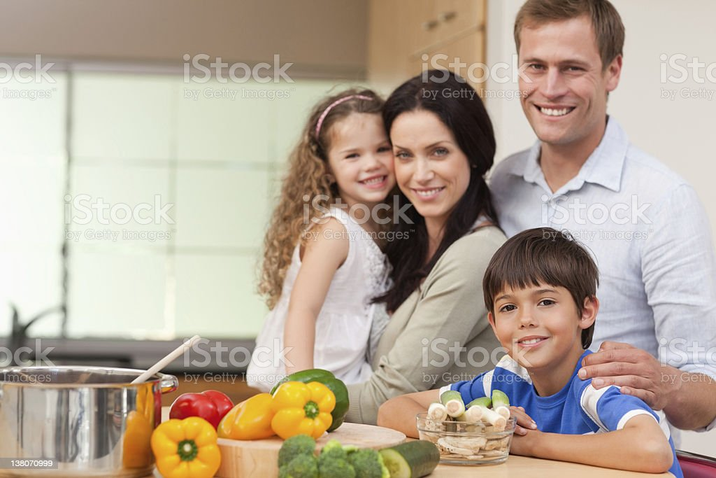 Smiling family standing in the kitchen royalty-free stock photo