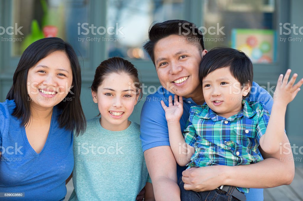 Smiling family with kids stock photo