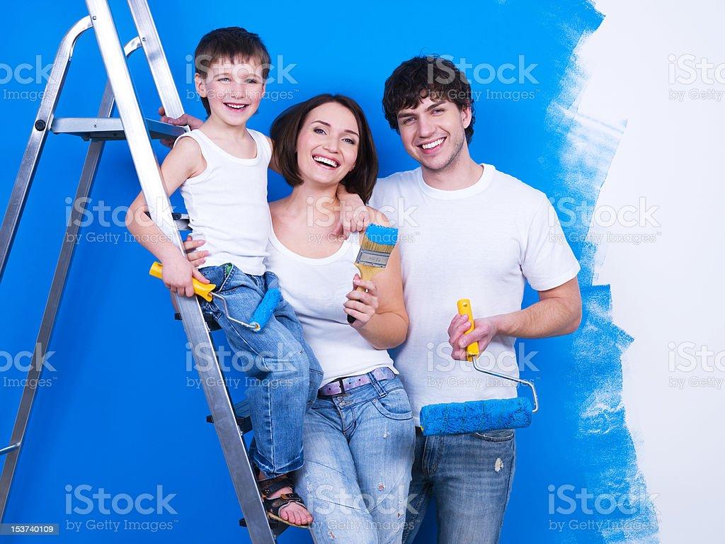 Smiling family with paintbrush royalty-free stock photo