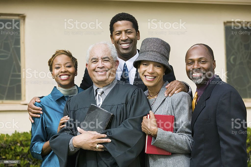 Smiling Family with Preacher stock photo