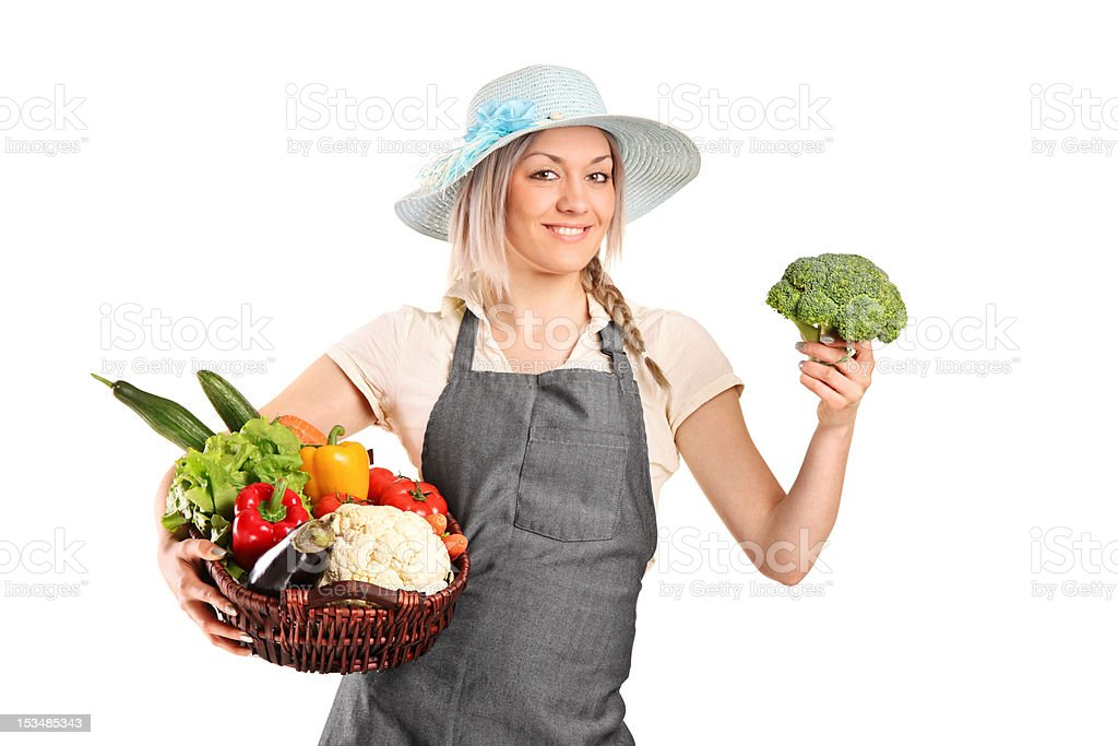 Smiling farmer holding a various vegetables royalty-free stock photo