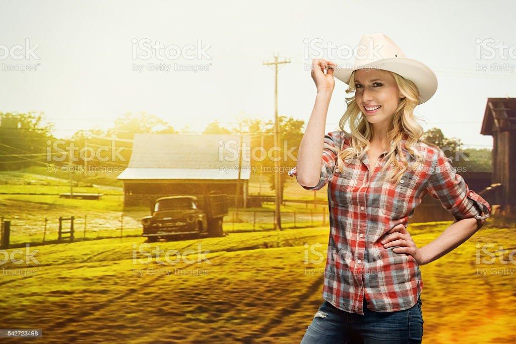 Smiling farmer standing farm stock photo