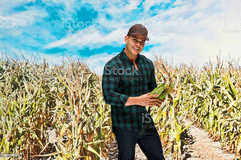 Smiling farmer standing in farm stock photo