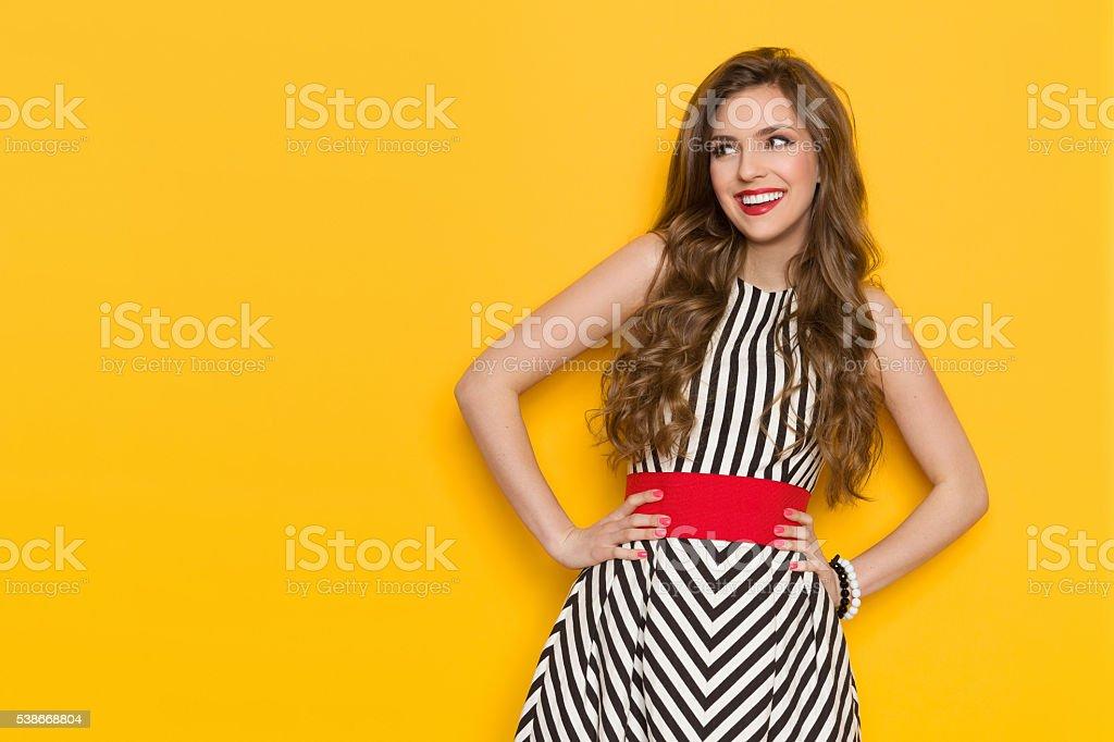 Smiling Fashionable Girl Looking Away stock photo