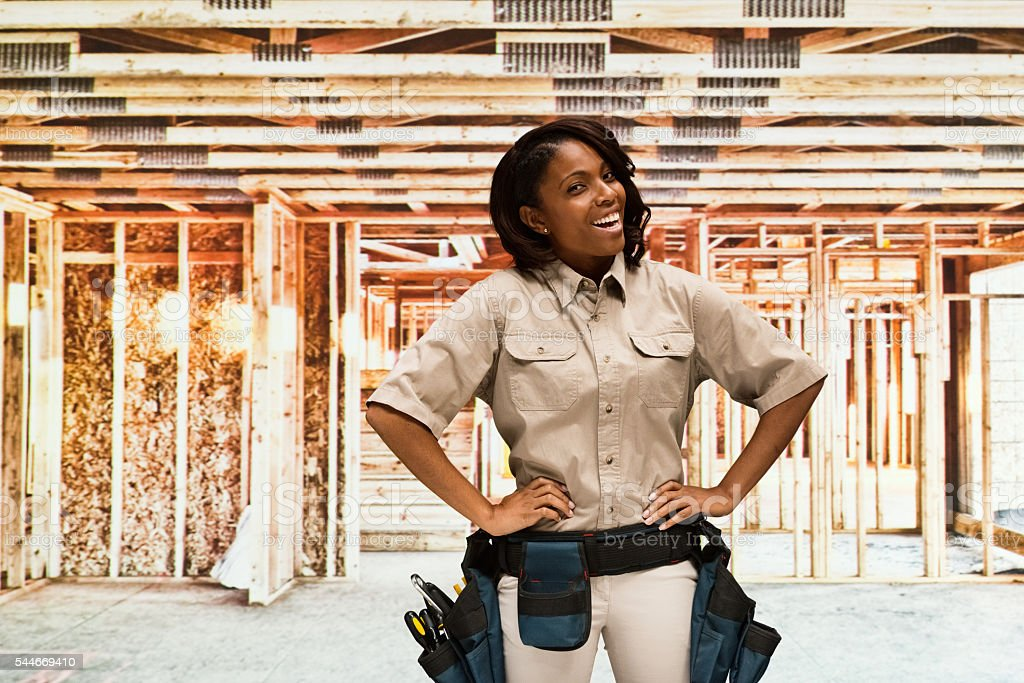 Smiling female building contractor stock photo