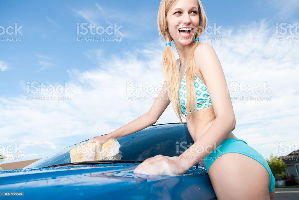 Smiling Female Car Washing royalty-free stock photo