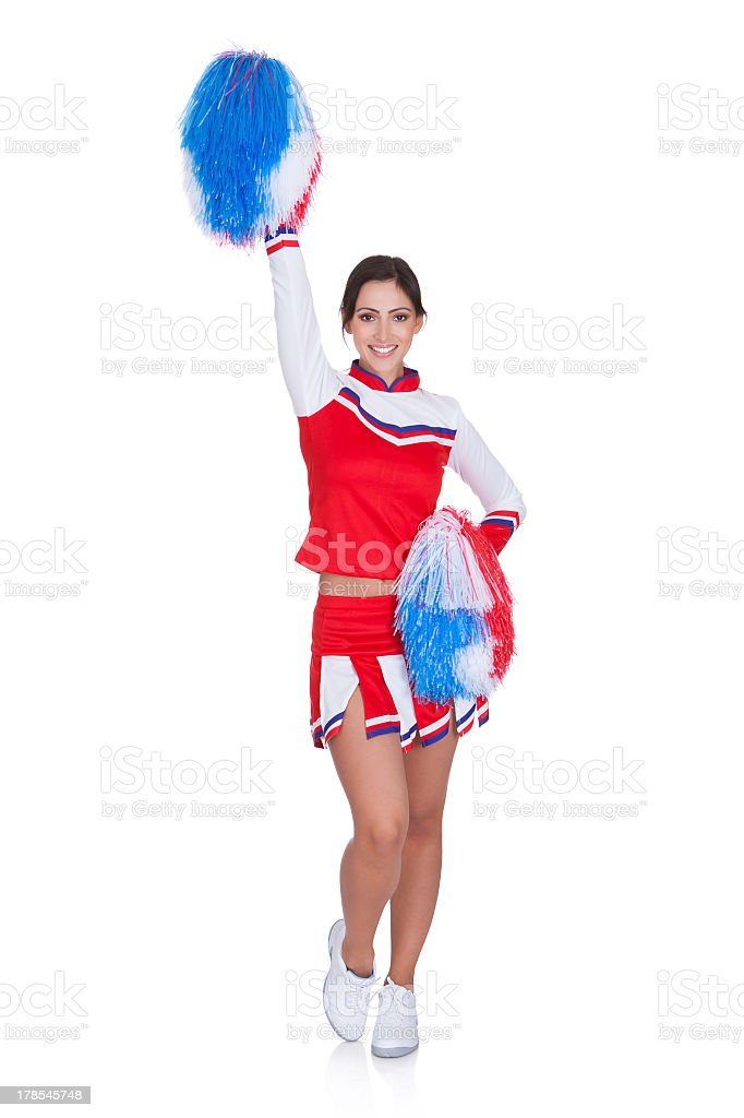 A smiling female cheerleader isolated on white stock photo