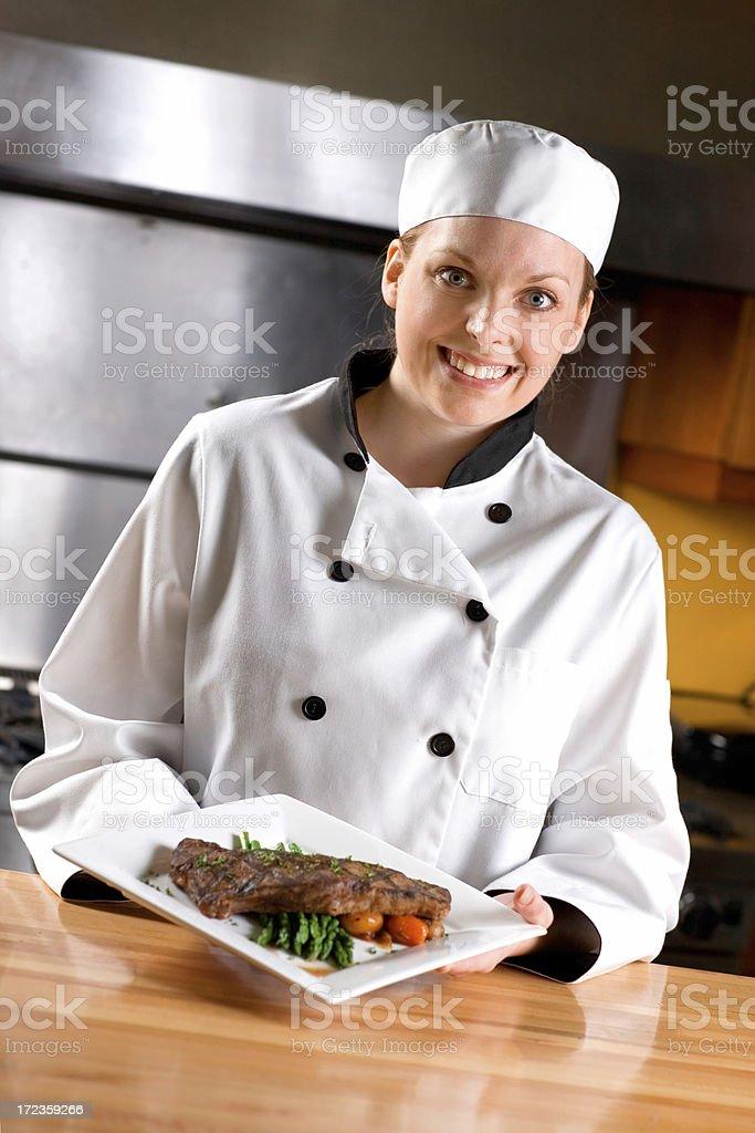 Smiling Female Chef stock photo