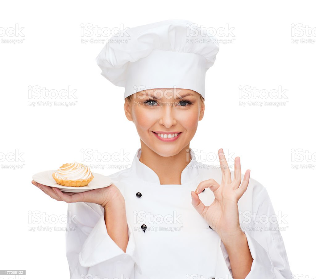 smiling female chef with cake on plate stock photo