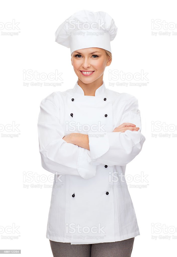 smiling female chef with crossed arms stock photo