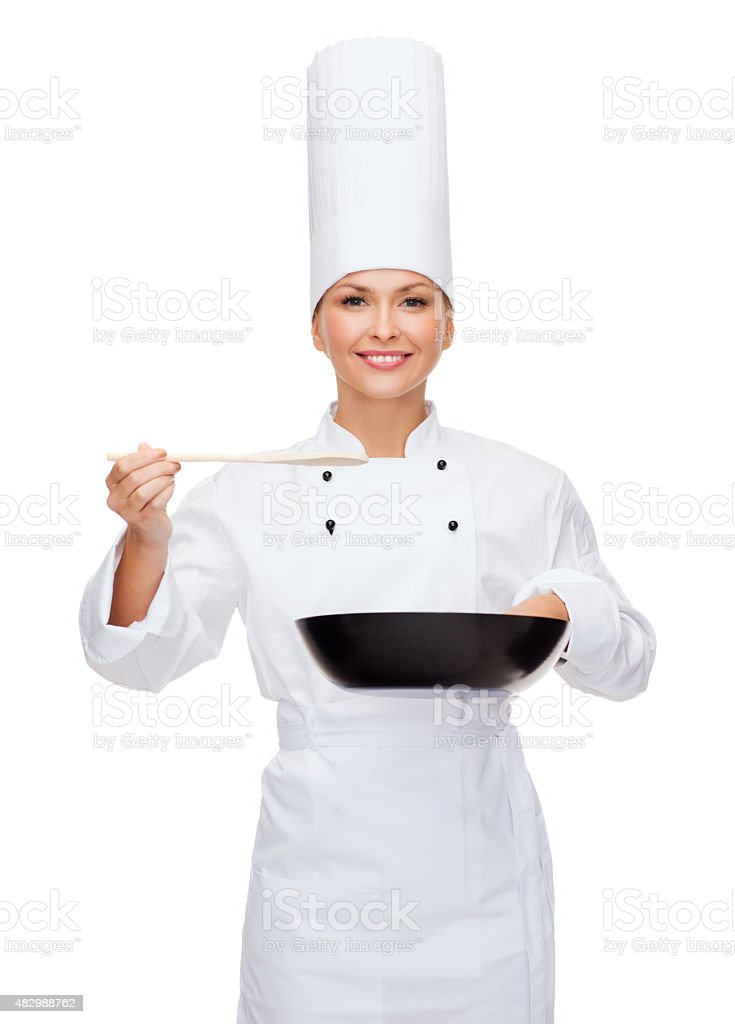 smiling female chef with pan and spoon stock photo