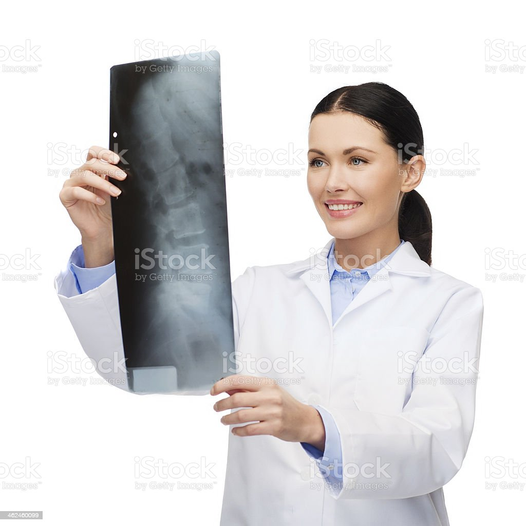 smiling female doctor looking at x-ray image stock photo