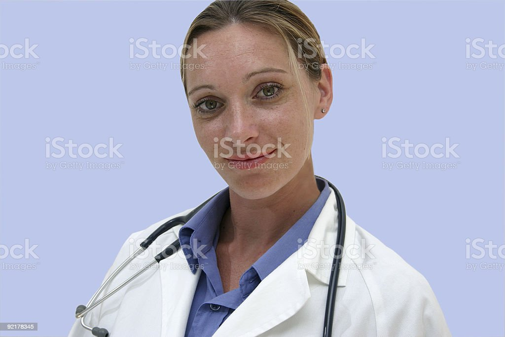 smiling female doctor presents royalty-free stock photo