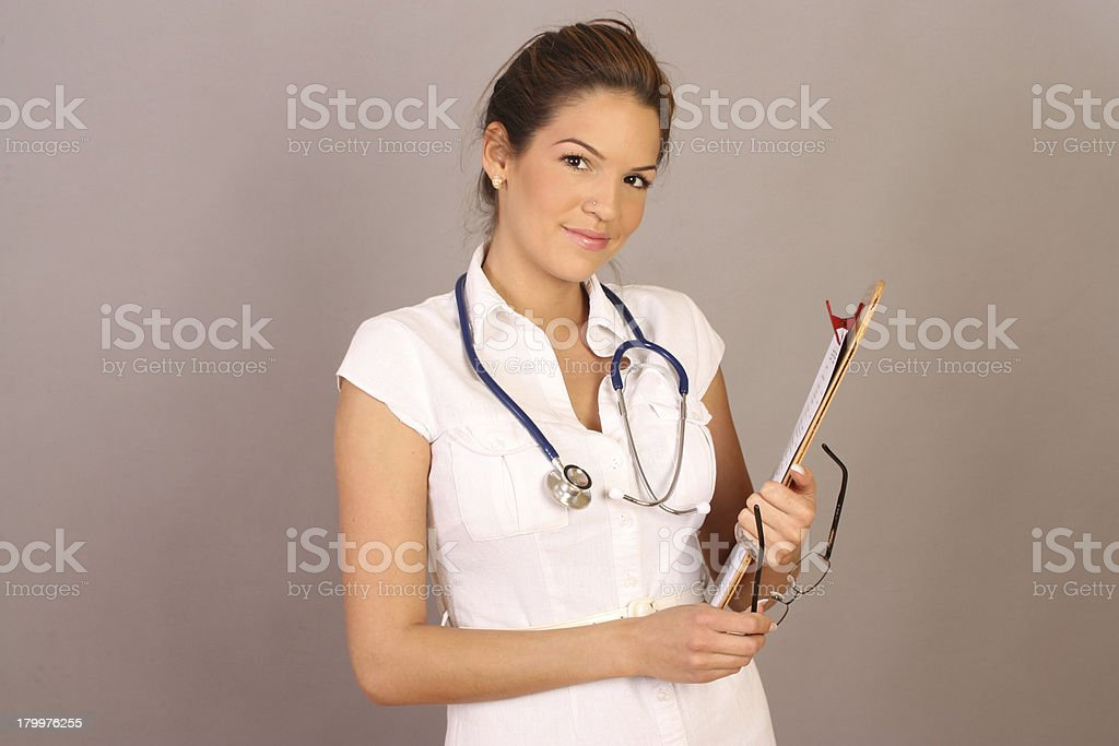Smiling female doctor with stethoscope royalty-free stock photo