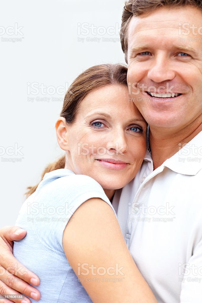 Smiling female embracing her husband royalty-free stock photo