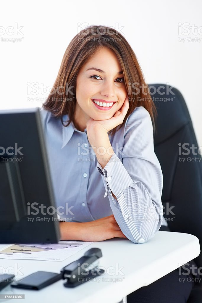 Smiling female executive stock photo