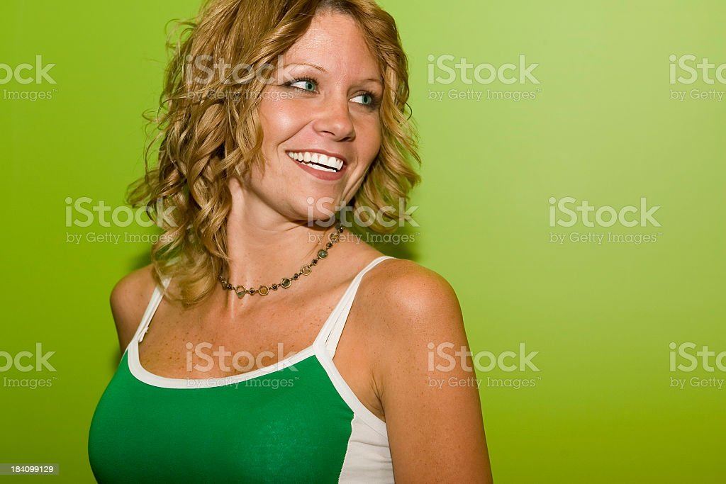 Smiling Female Fashion Model on Green stock photo