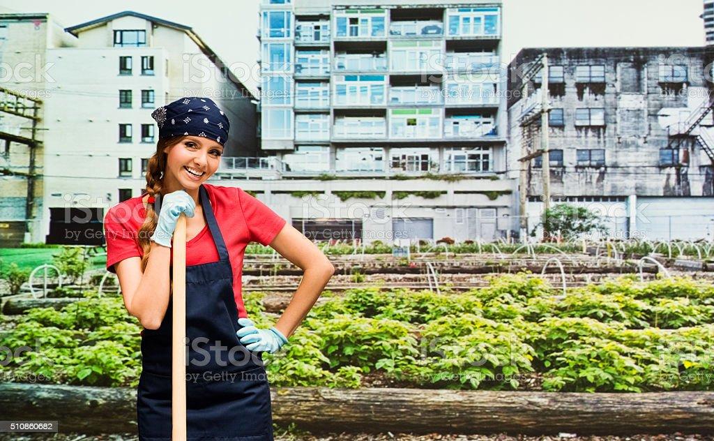 Smiling female gardener in the garden stock photo