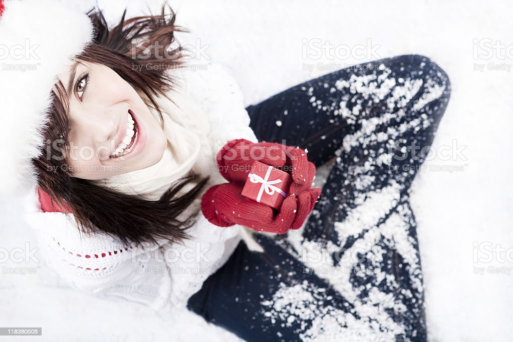 Smiling female holding a red christmas present royalty-free stock photo
