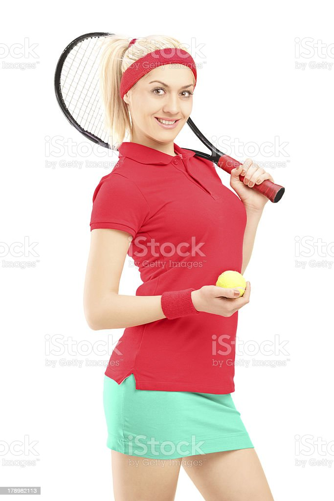 Smiling female holding a tennis racket and ball royalty-free stock photo