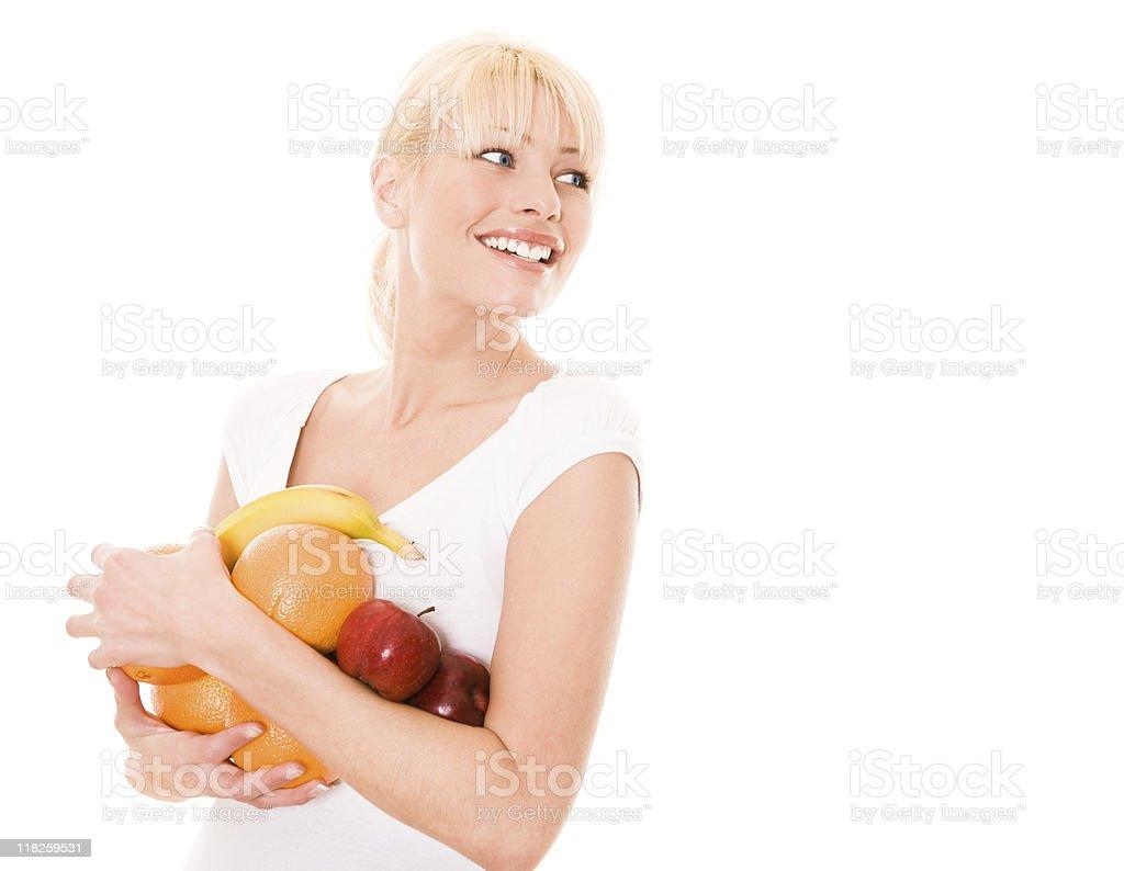 Smiling female holding fruits royalty-free stock photo