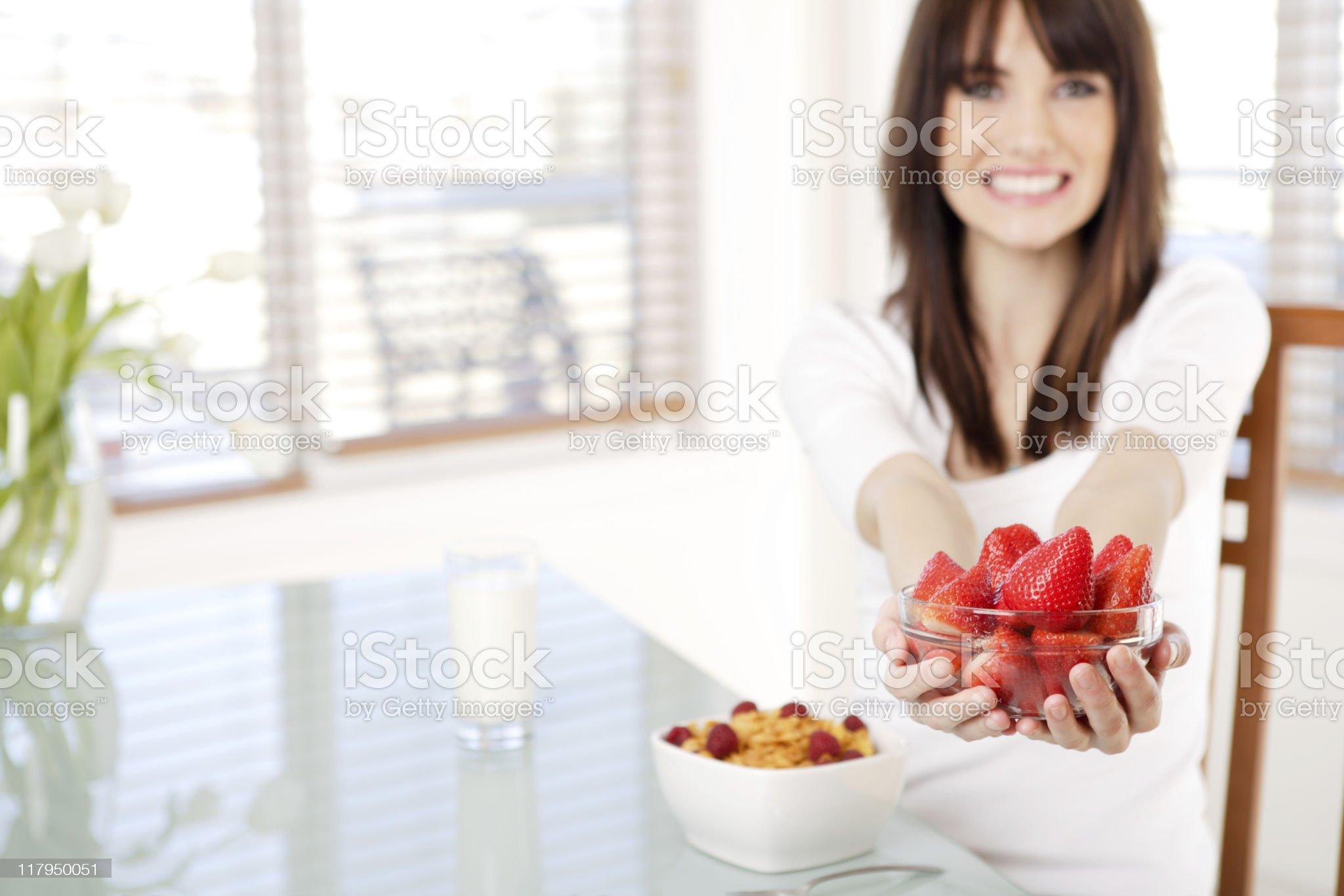 Smiling female holding strawberry royalty-free stock photo