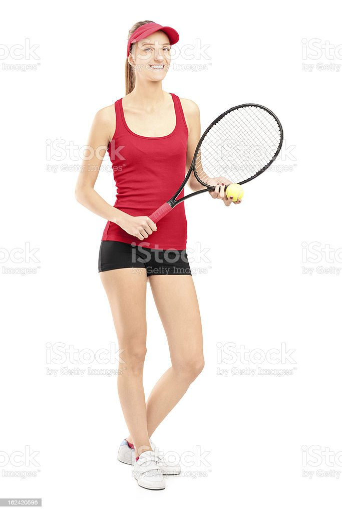 Smiling female holding tennis racket and ball royalty-free stock photo
