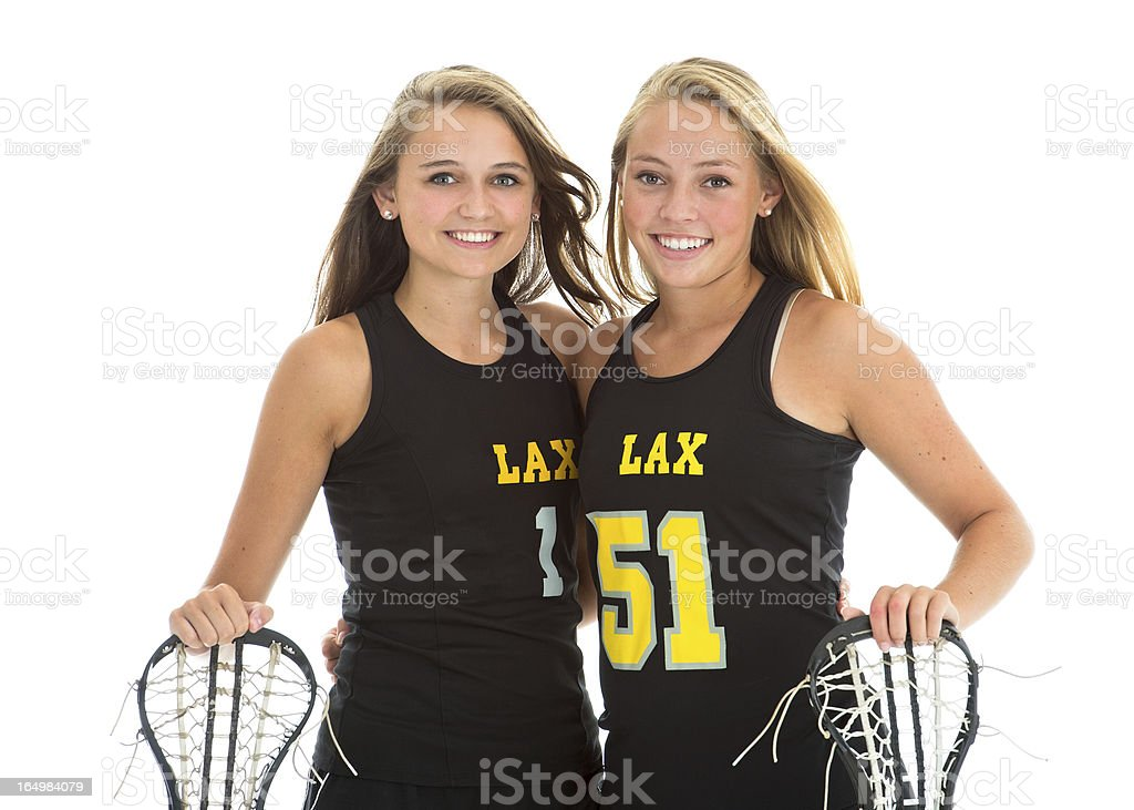Smiling female lacrosse players with sticks, studio isolated on stock photo