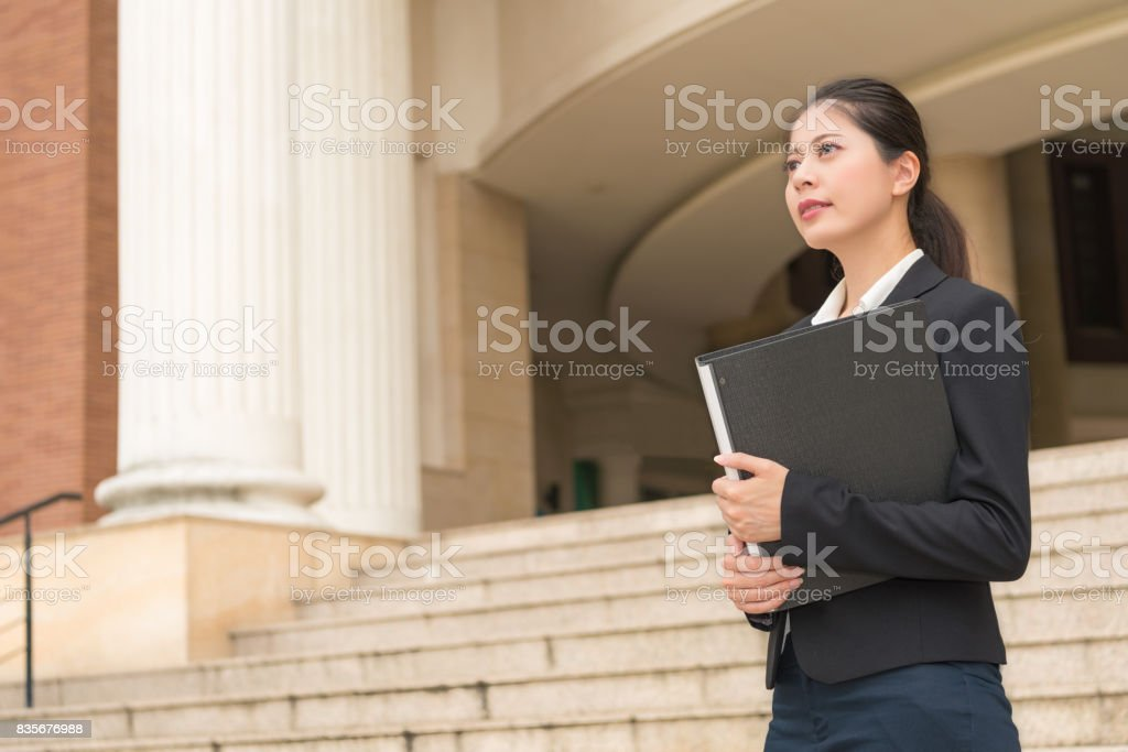 smiling female lawyer holding legal case file stock photo